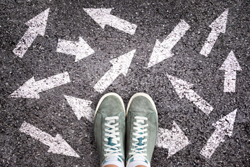 Looking down at my own sneakers, the pavement covered in arrows pointing in all directions
