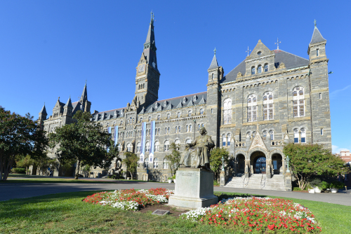 Large, gray, neo-Gothic, granite college campus building, Georgetown Univ. campus.